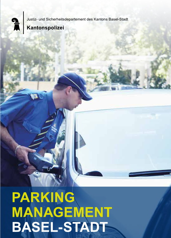 Cover Publication: A policeman controls the windshield of a parking car looking for a parking ticket.